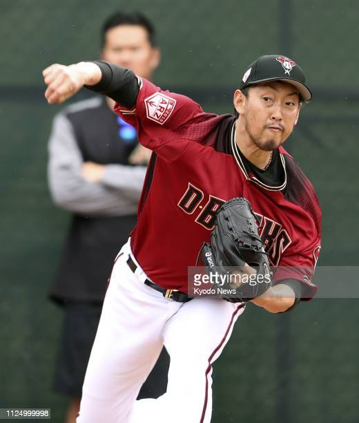 Yoshihisa Hirano of the Arizona Diamondbacks throws a bullpen session at the club's spring training facility in Scottsdale Arizona on Feb 14 2019...