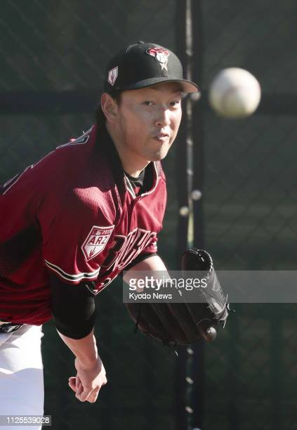 Yoshihisa Hirano of the Arizona Diamondbacks throws a bullpen session during the team's spring training in Scottsdale Arizona on Feb 17 2019 ==Kyodo