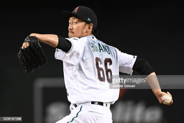 Yoshihisa Hirano of the Arizona Diamondbacks throws a warm up pitch in the tenth inning of the MLB game against the Atlanta Braves at Chase Field on...