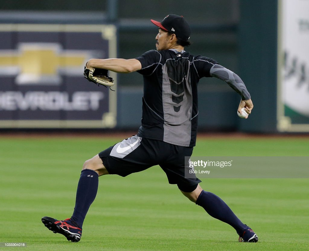 Yoshihisa Hirano #66 of the Arizona Diamondbacks throws during a warm up session before the game against the Houston Astros at Minute Maid Park on September 14, 2018 in Houston, Texas.
