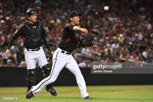 Yoshihisa Hirano of the Arizona Diamondbacks throws the ball to make an out against the Atlanta Braves in the ninth inning of the MLB game at Chase...