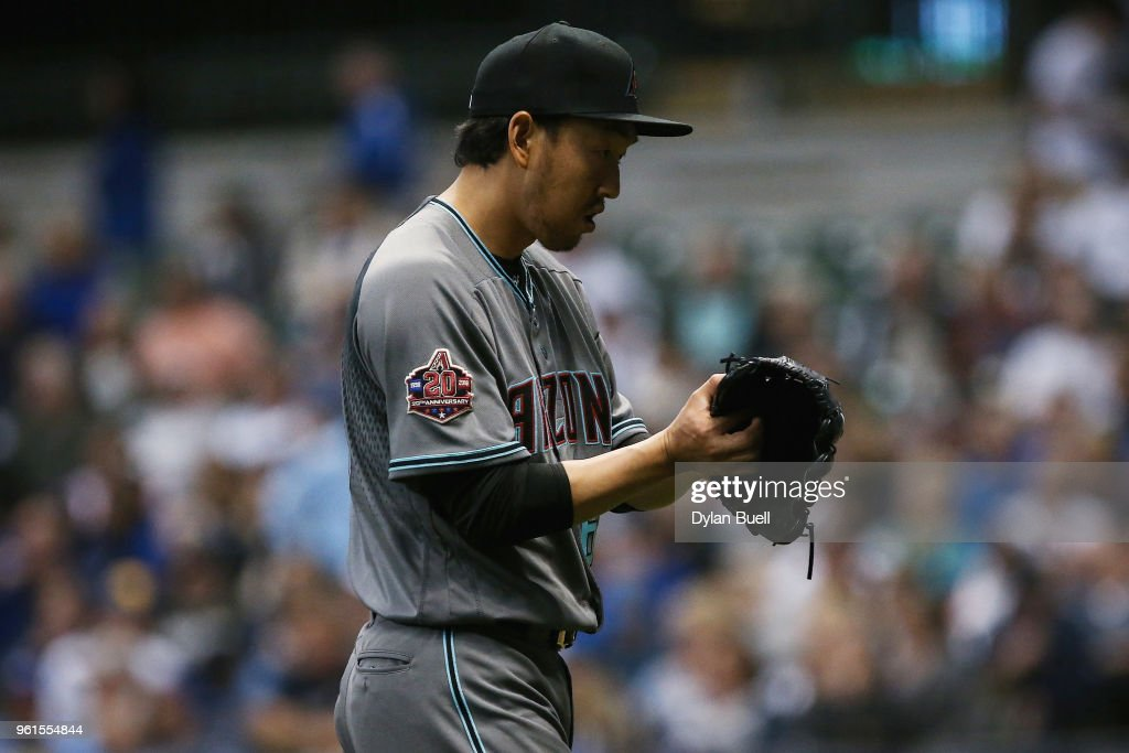 Yoshihisa Hirano #66 of the Arizona Diamondbacks walks off the field after the seventh inning against the Milwaukee Brewers at Miller Park on May 22, 2018 in Milwaukee, Wisconsin.