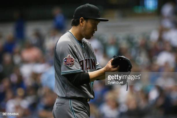 Yoshihisa Hirano of the Arizona Diamondbacks walks off the field after the seventh inning against the Milwaukee Brewers at Miller Park on May 22 2018...