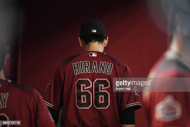 Yoshihisa Hirano of the Arizona Diamondbacks walks to the end of the dugout after pitching in the tenth inning against the San Diego Padres at Chase...