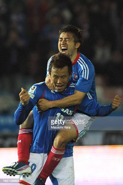 Yoshihito Fujita and Takashi Amano of Yokohama FMarinos celebrate the third goal during the JLeague match between Yokohama FMarinos and FC Tokyo at...