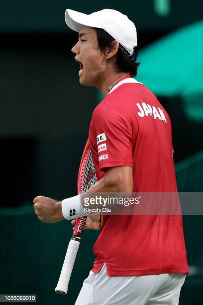Yoshihito Nishioka of Japan celebrates a point in his singles match against Mirza Basic of Bosnia and Herzegovina during day one of the Davis Cup...