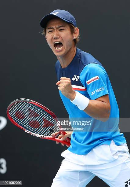 Yoshihito Nishioka of Japan celebrates after winning a point during his Men's Singles second round match against Daniel Evans of Great Britain on day...
