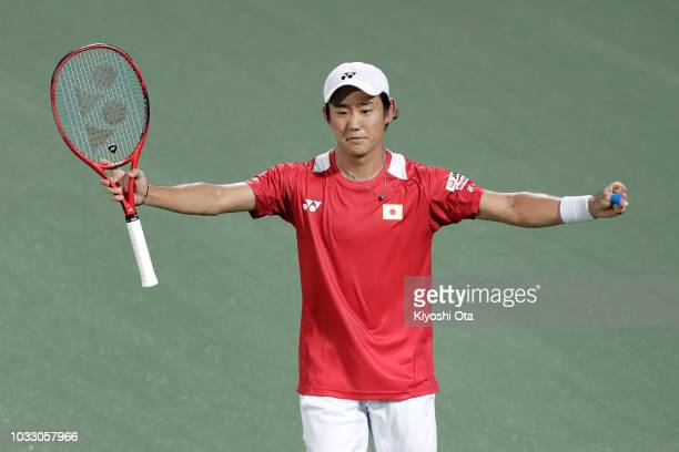 Yoshihito Nishioka of Japan celebrates after winning his singles match against Mirza Basic of Bosnia and Herzegovina during day one of the Davis Cup...
