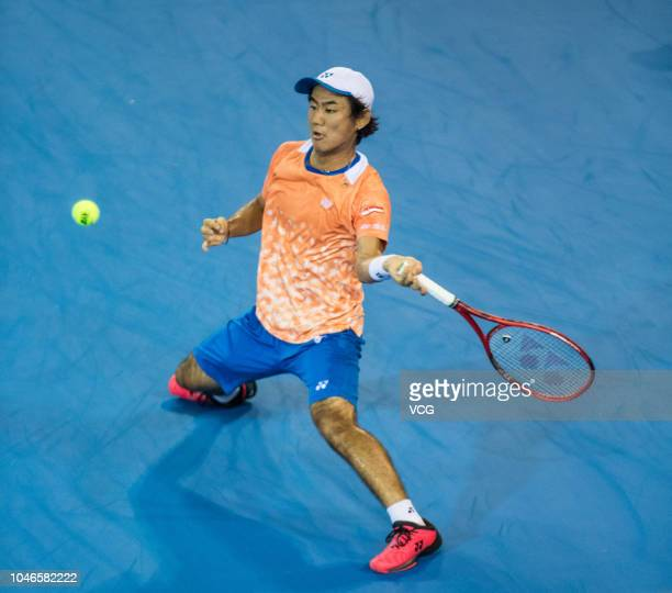 Yoshihito Nishioka of Japan competes in the semifinal match against Cameron Norrie of Great Britain on day 6 of the ATP Shenzhen Open tennis...