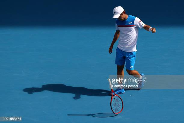Yoshihito Nishioka of Japan drops his racquet during his Men's Singles third round match against Novak Djokovic of Serbia on day five of the 2020...