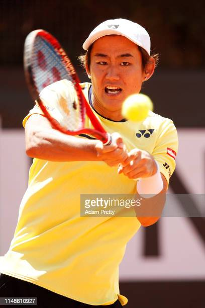 Yoshihito Nishioka of Japan hits a backhand during his match against Damir Dzumhur of Bosnia and Herzegovina on day 1 of the Internazionali BNL...