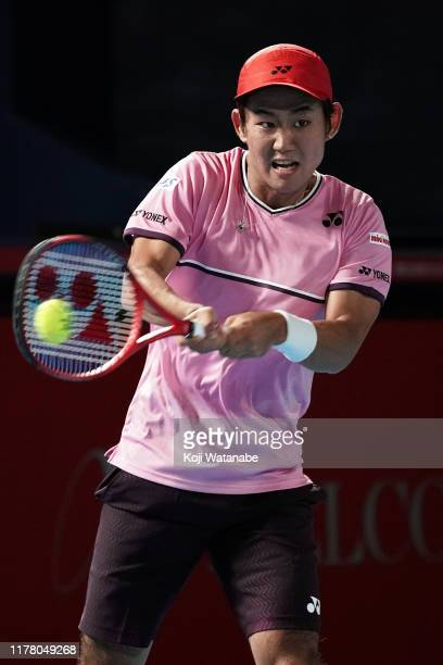 Yoshihito Nishioka of Japan hits a return shot against Joao Sousa of Portugal on day one of the Rakuten Open at the Ariake Coliseum on September 30...