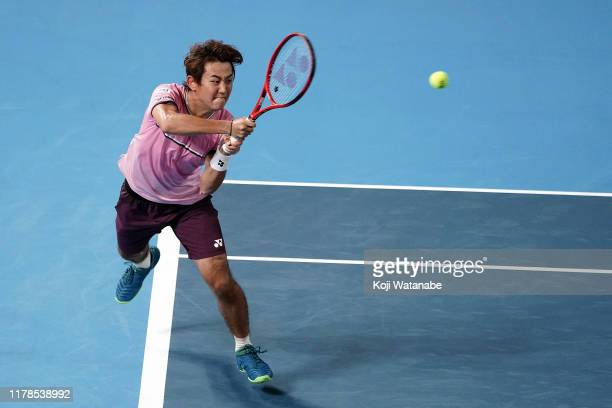 Yoshihito Nishioka of Japan hits a return shot against Lucas Pouille of France day three of the Rakuten Open at the Ariake Coliseum on October 02...