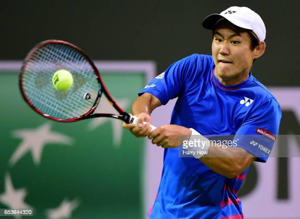 Yoshihito Nishioka of Japan plays a backhand as he loses to Stan Wawrinka of Switzerland during the BNP Paribas at Indian Wells Tennis Garden on...