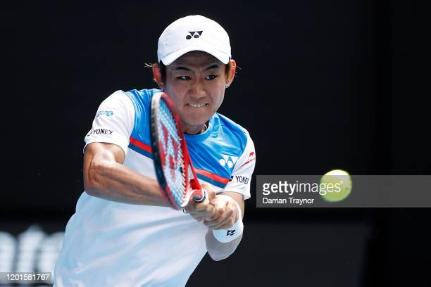 Yoshihito Nishioka of Japan plays a backhand during his Men's Singles third round match against Novak Djokovic of Serbia on day five of the 2020...