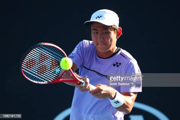 Yoshihito Nishioka of Japan plays a backhand in his first round match against Tennys Sandgren of the United States during day one of the 2019...