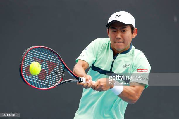 Yoshihito Nishioka of Japan plays a backhand in his first round match against Philipp Kohlschreiber of Germany on day one of the 2018 Australian Open...