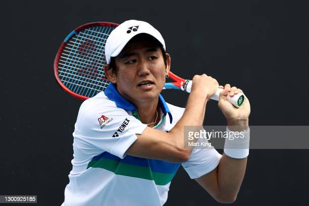 Yoshihito Nishioka of Japan plays a backhand in his Men's Singles first round match against Pedro Martinez of Spain during day one of the 2021...
