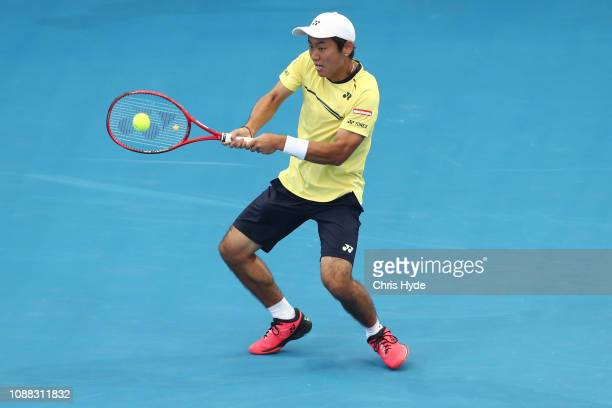 Yoshihito Nishioka of Japan plays a backhand is his match against Grigor Dimitrov of Bulgaria during day two of the 2019 Brisbane International at...
