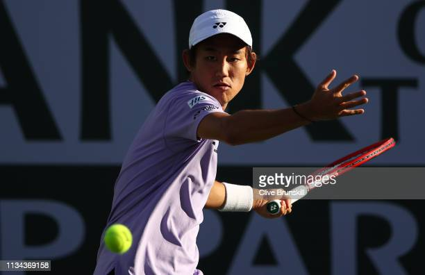 Yoshihito Nishioka of Japan plays a forehand against Denis Kudla of the United States during their men's singles first round match on day four of the...