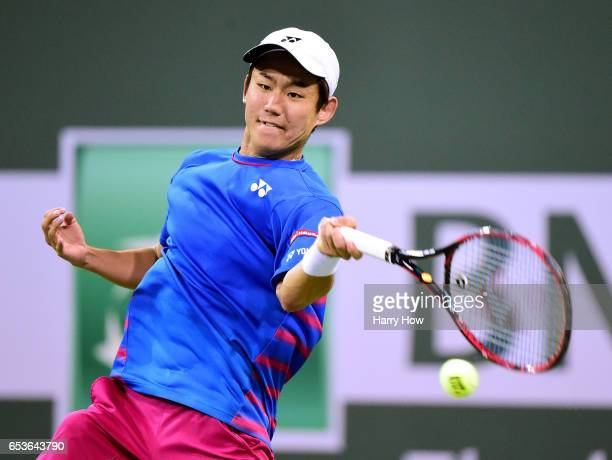 Yoshihito Nishioka of Japan plays a forehand as he loses to Stan Wawrinka of Switzerland during the BNP Paribas at Indian Wells Tennis Garden on...