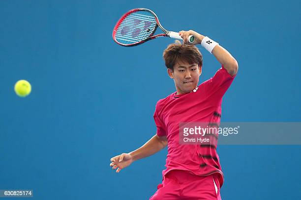 Yoshihito Nishioka of Japan plays a forehand during his match against Viktor Troicki of Serbia on day three of the 2017 Brisbane International at Pat...