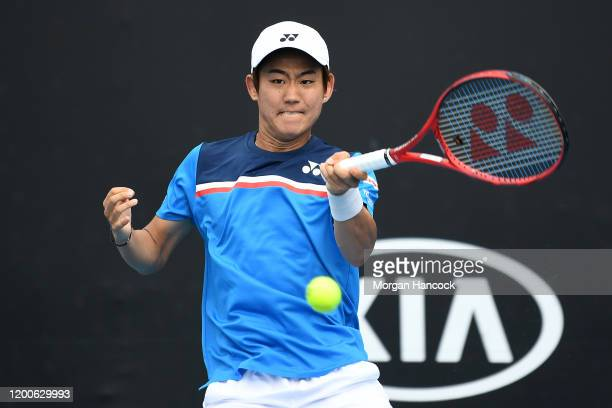 Yoshihito Nishioka of Japan plays a forehand during his Men's Singles first round match against Laslo Djere of Serbia on day one of the 2020...