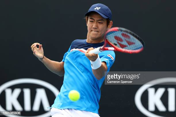 Yoshihito Nishioka of Japan plays a forehand during his Men's Singles second round match against Daniel Evans of Great Britain on day three of the...