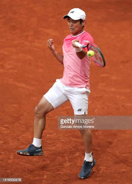 Yoshihito Nishioka of Japan plays a forehand during his second round match against Casper Ruud of Norway during day seven of the Mutua Madrid Open at...