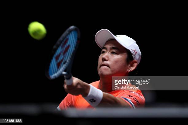 Yoshihito Nishioka of Japan plays a forehand during the match between Yoshihito Nishioka of Japan and Felix Auger-Aliassime of Canada of day five of...