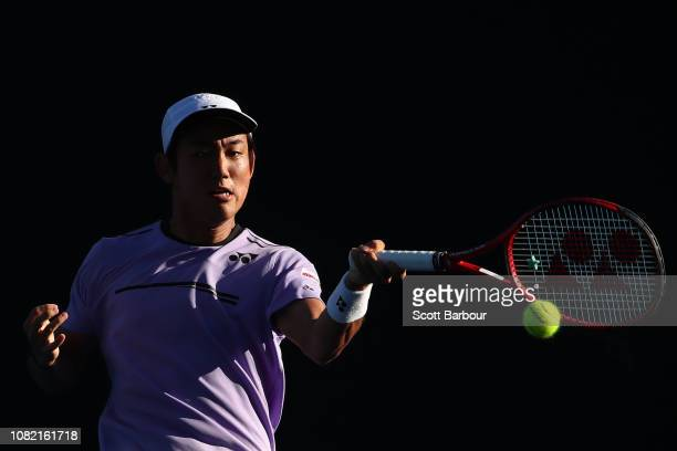 Yoshihito Nishioka of Japan plays a forehand in his first round match against Tennys Sandgren of the United States during day one of the 2019...