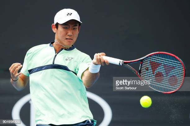 Yoshihito Nishioka of Japan plays a forehand in his first round match against Philipp Kohlschreiber of Germany on day one of the 2018 Australian Open...