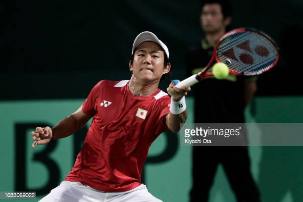 Yoshihito Nishioka of Japan plays a forehand in his singles match against Mirza Basic of Bosnia and Herzegovina during day one of the Davis Cup World...