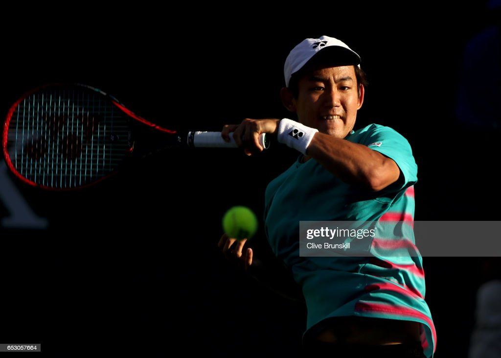 Yoshihito Nishioka of Japan plays a forehand in his third round match against Tomas Berdych of the Czech Republic during day eight of the BNP Paribas Open at Indian Wells Tennis Garden on March 13, 2017 in Indian Wells, California.