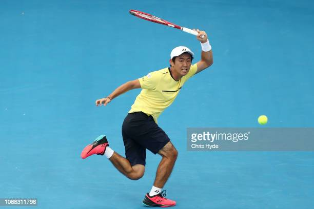 Yoshihito Nishioka of Japan plays a forehand is his match against Grigor Dimitrov of Bulgaria during day two of the 2019 Brisbane International at...