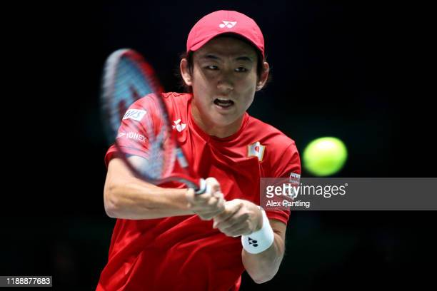 Yoshihito Nishioka of Japan plays a forehand shot during his Davis Cup group stage match against Novak Djokovic of Serbia during Day Three of the...