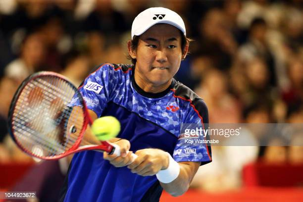 Yoshihito Nishioka of Japan plays a fourhand in the Singles first round against Nick Kyrgios of Australia on day three of the Rakuten Open at...