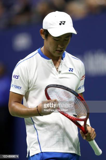 Yoshihito Nishioka of Japan reacts during his men's singles first round match against Roger Federer of Switzerland on Day Two of the 2018 US Open at...