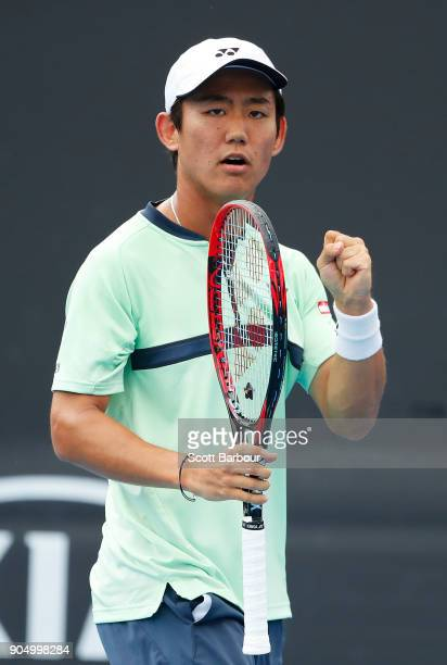 Yoshihito Nishioka of Japan reacts in his first round match against Philipp Kohlschreiber of Germany on day one of the 2018 Australian Open at...
