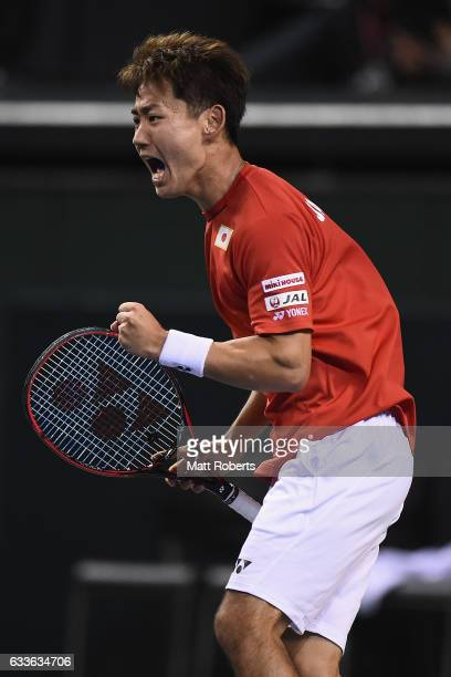 Yoshihito Nishioka of Japan reacts in his match against Gilles Simon of France during the Davis Cup by BNP Paribas first round singles match between...