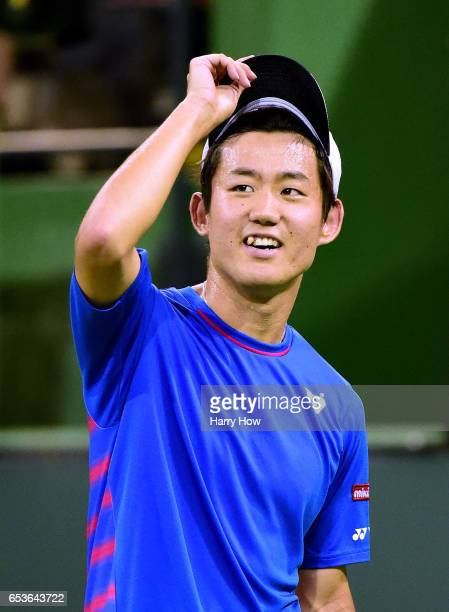 Yoshihito Nishioka of Japan reacts to a point as he loses to Stan Wawrinka of Switzerland during the BNP Paribas at Indian Wells Tennis Garden on...