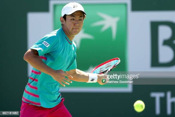 Yoshihito Nishioka of Japan returns a shot to Ivo Karlovic of Croatia during the BNP Paribas Open at the Indian Wells Tennis Garden on March 11 2017...
