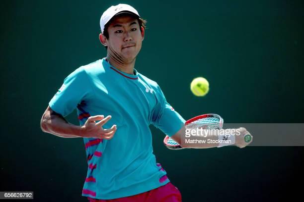 Yoshihito Nishioka of Japan returns a shot to Jordan Thompson of Australia during the Miami Open at the Crandon Park Tennis Center on March 22 2017...
