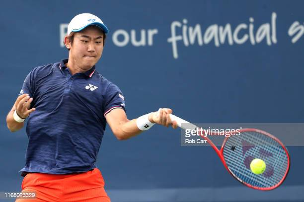 Yoshihito Nishioka of Japan returns a shot to Kei Nishikori of Japan during Day 5 of the Western and Southern Open at Lindner Family Tennis Center on...