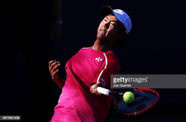 Yoshihito Nishioka of Japan returns a shot to Kevin Anderson of South Africa during his first round Men's Singles match on Day One of the 2016 US...