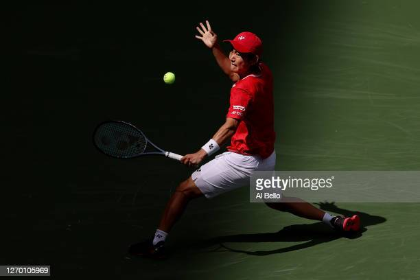 Yoshihito Nishioka of Japan returns the ball during his Men's Singles first round match against Andy Murray of Great Britain on Day Two of the 2020...