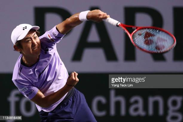 Yoshihito Nishioka of Japan serves against Roberto Bautista Agut of Spain during their men's singles second round match on Day 6 of the BNP Paribas...