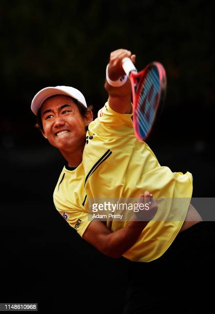 Yoshihito Nishioka of Japan serves during his match against Damir Dzumhur of Bosnia and Herzegovina on day 1 of the Internazionali BNL d'Italia at...
