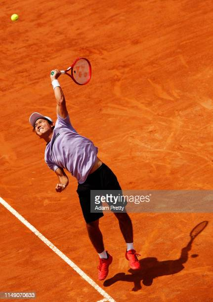 Yoshihito Nishioka of Japan serves during his match against Diego Schwartzman of Argentina during day three of the International BNL d'Italia at Foro...