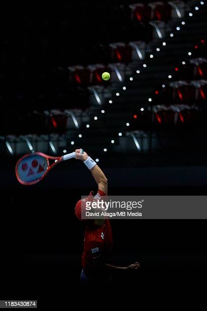 Yoshihito Nishioka of Japan serves during his match against Gael Monfils of France during Day two of the 2019 Davis Cup at La Caja Magica on November...